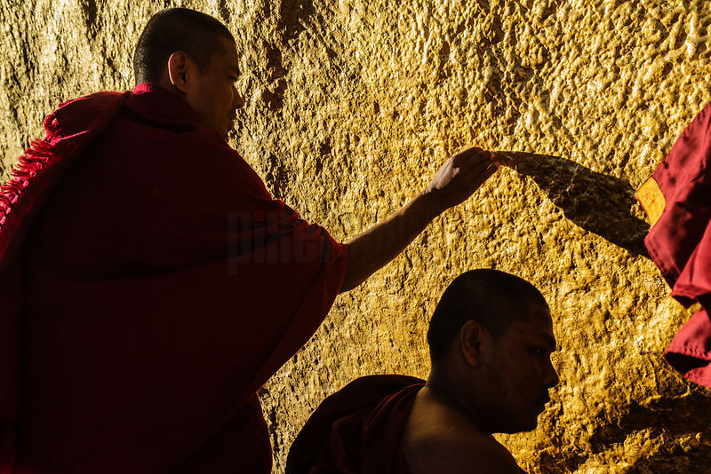 Monks Applying Gold Leaf to the Golden Rock