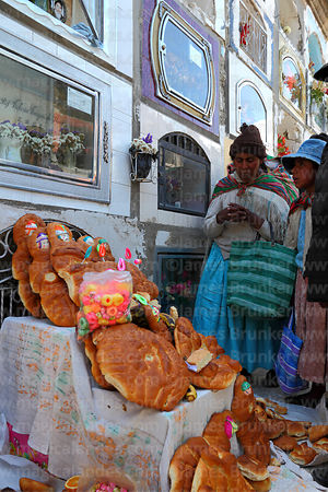 Family saying farewell to soul of deceased relative in cemetery during Todos Santos festival, La Paz, Bolivia
