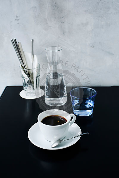 A cup of black coffee on Cafe table