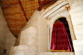 Rear view of statue and altarscreen of St Peter / San Pedro church, Guañacagua, Region XV, Chile