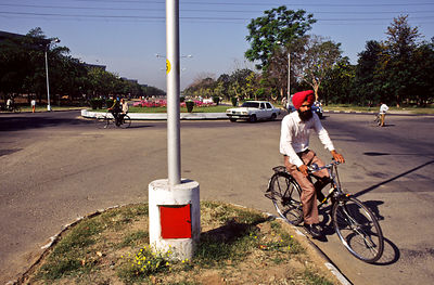 India - Chandigarh - A cyclist rides the planned, wide avenues of Chandigarh