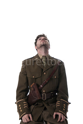 A first world war British officer kneeling and looking up – shot from mid level.