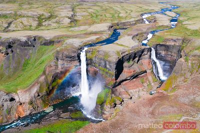 Aerial drone view of Haifoss double waterfall with rainbow, Iceland
