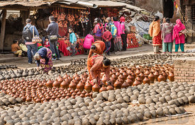 Woman checking pots Bhaktapur.