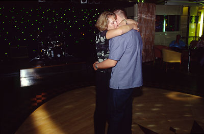 A couple slow dance at the end of a party on board the P&O liner Oriana.