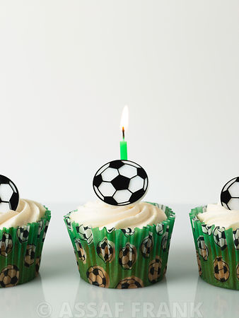 Football capcake with birthday candle