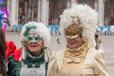 Women in St Mark's Square posing in period costumes and white wigs