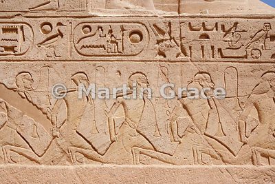 Depiction of Asiatic prisoners of war on the throne of a colossus of Ramesses II, Sun Temple of Abu Simbel, Egypt