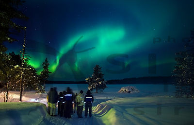 Tourists admiring the Northern Lights