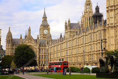 The Palace of Westminster with a Red London Bus passing by