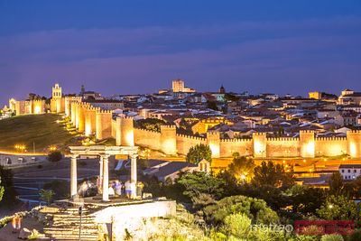 View of the old walled city at night, Avila, Spain