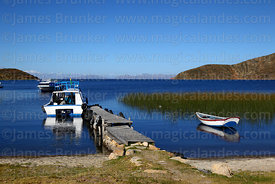 Boats moored next to jetty and totora reeds at Challapampa, Sun Island, Lake Titicaca, Bolivia