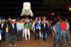People parade with lantern during festival, San Ignacio de Moxos, Bolivia