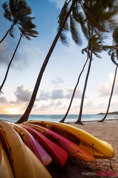 Colorful kayaks on beach in the Caribbean