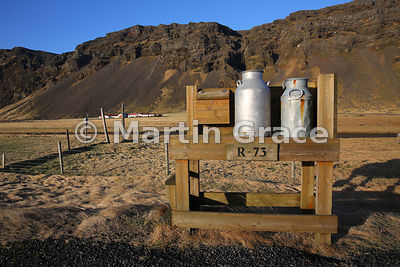 Traditional wooden stand for milk churns awaiting collection, Saudhusvollur, southern Iceland