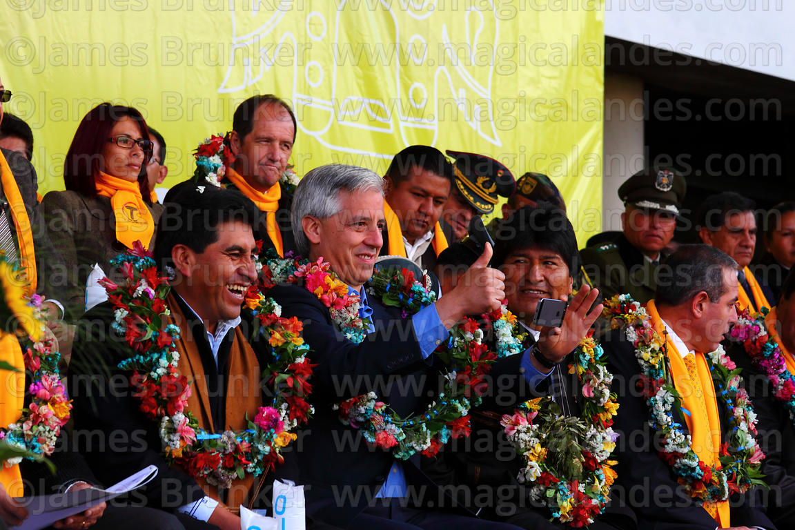 President Evo Morales (right centre) watches as vice president Alvaro Garica Linera (centre) takes a photo of a friend in the...