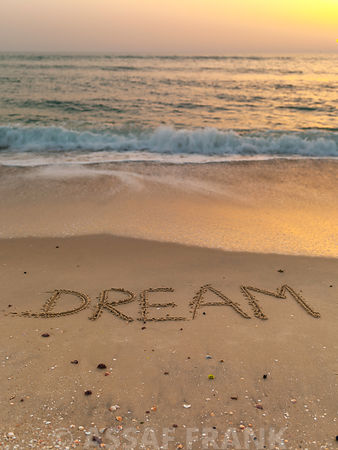 Sand writing - Word Dream written on beach