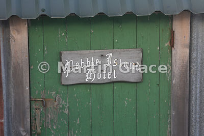 Pebble Island Hotel sign on the door of an outhouse - no not the main entrance to Pebble Island Lodge!
