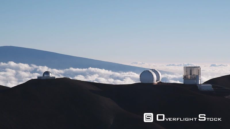 Past Mauna Loa Observatory with clouds in valley.