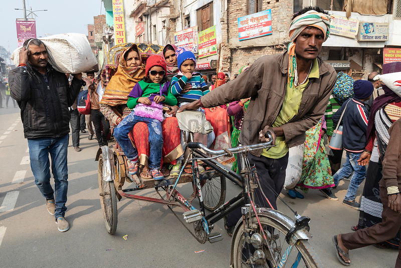A Rickshaw Wallah Transports a Family through Downtown Prayagraj