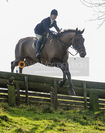 Annabel Bealby jumping a hunt jump in Flitteris Park