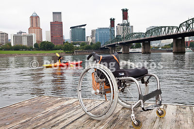 Young paraplegic woman canoeing on a city river