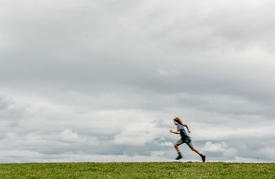 Danish boy running in a field 4