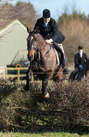 Jeremy Dale jumping the first hedge