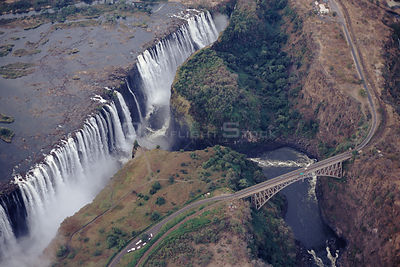 Aerial view of Victoria Falls showing rainbow, arm chair and Zambezi bridge. Zimbabwe, Southern Africa