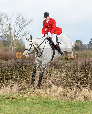 David Bellamy jumping a hedge at Eaton Grange. The Belvoir Hunt at Eaton Grange 7/2