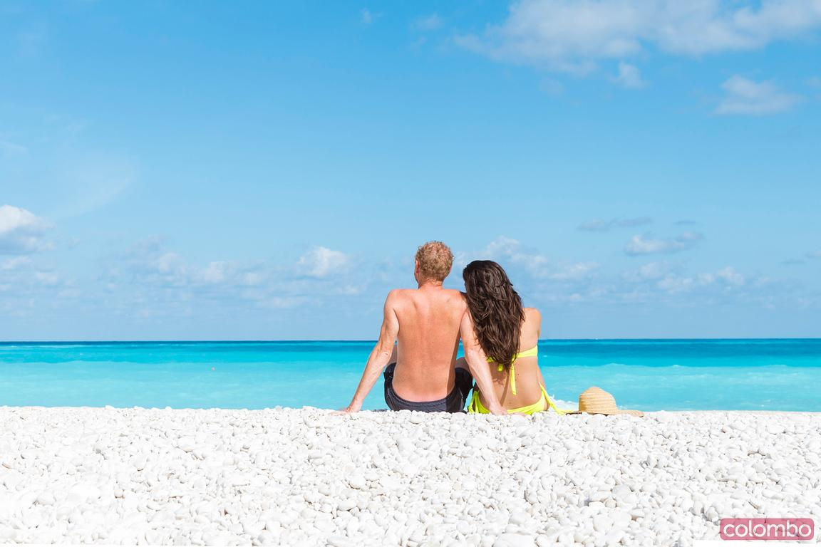 Tourist couple at famous Myrtos beach, Kefalonia, Greek Islands, Greece