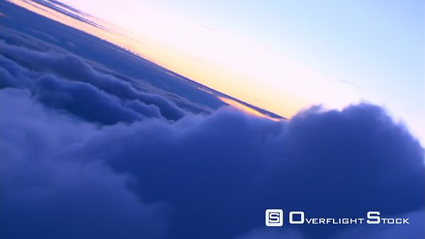 Steeply tilting flight through clouds, passenger POV