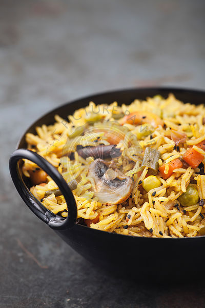 Indianrice dis vegetarian pulao in the black bowl. With copy space