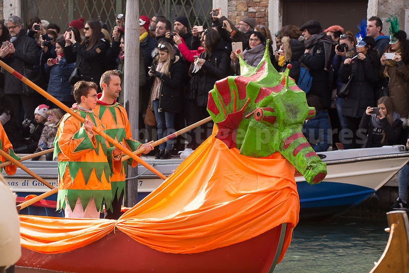 Dragon Boat and Costumed Men in the Venice Carnival Water Parade on the Rio di Cannaregio Canal