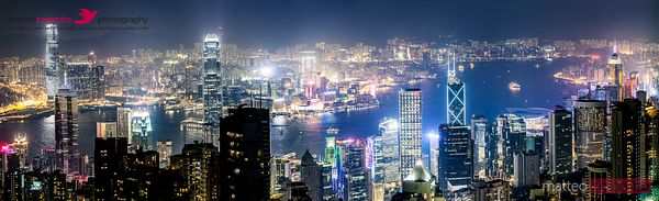 Panoramic of Hong Kong harbor from Victoria peak at night