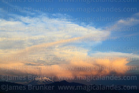 Dramatic clouds above Mt Illimani at sunset, Cordillera Real, Bolivia