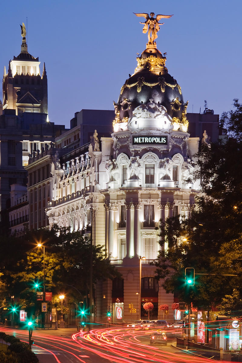 Grand Via and Metropolis Building at Dusk Madrid Spain