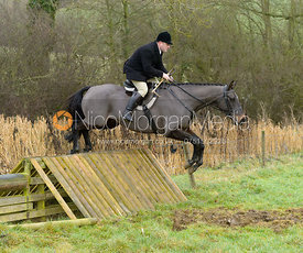 Stephen Hill jumping a hunt jump at Peakes - The Fitzwilliam Hunt visit the Cottesmore at Burrough House
