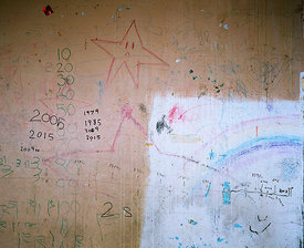 Child's drawings and timeline history of Barry Jackson Toweron wall of recently vacated flat 119,  on the top floor of Barry ...