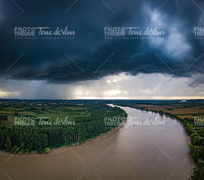 The river with a storm and a rain in the summer, Garonne river, Gironde