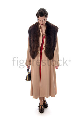 A vintage 1920s - 1930s woman in a big coat and fur – shot from eye level.