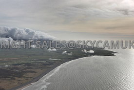 Cumbrian aerial photograph of the coastline with clouds and a winter sky