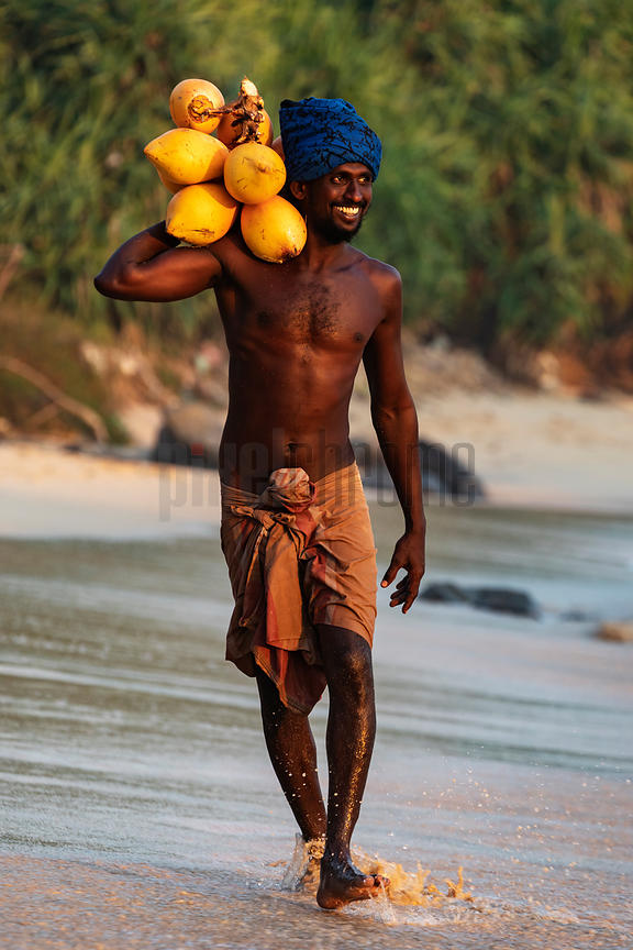 Stilt Fisherman Carrying a Bunch of Coconuts