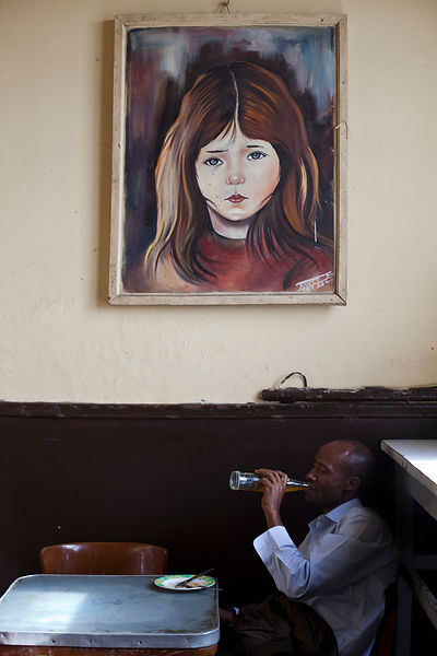 Ethiopia - Addis Ababa - A customer in the Ras Makonnen coffee house