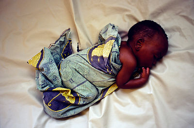 Burundi - Ruyigi - A new born baby asleep in a cot
