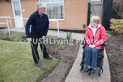 Husband and wife in adapted home gardening.