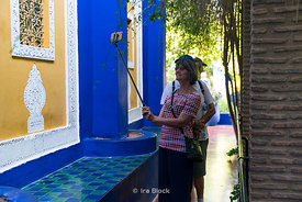 Tourists taking selfie at the Jardin Majorelle n Marrakesh, Morocco
