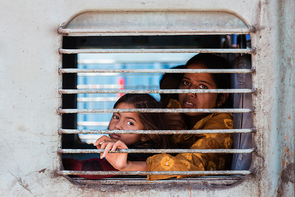 Portrait of a Woman and her Daughter in a Train Carriage