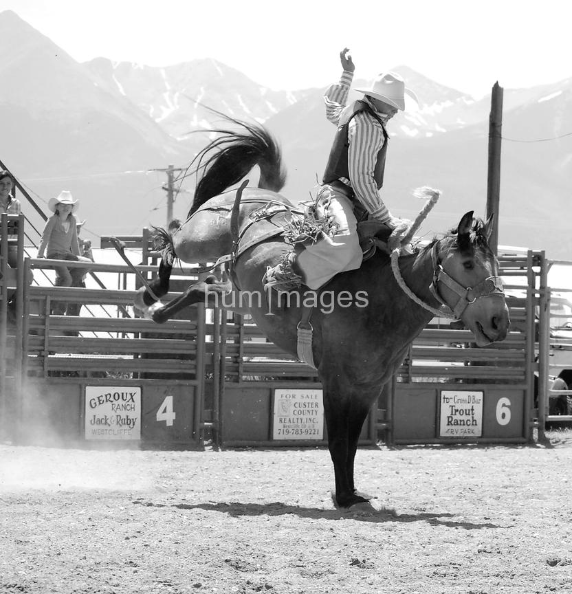 Black and white photo of bronc riding rodeo cowboy