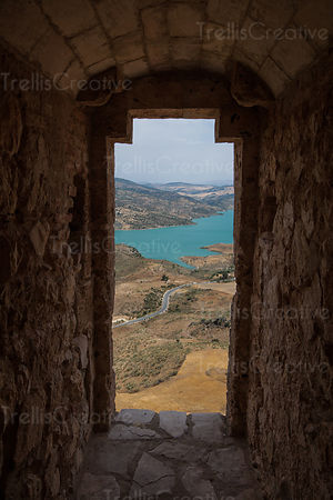 Scenics view of lake seen through window in stone wall